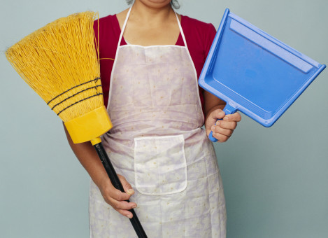Woman Holding Broom and Dustpan